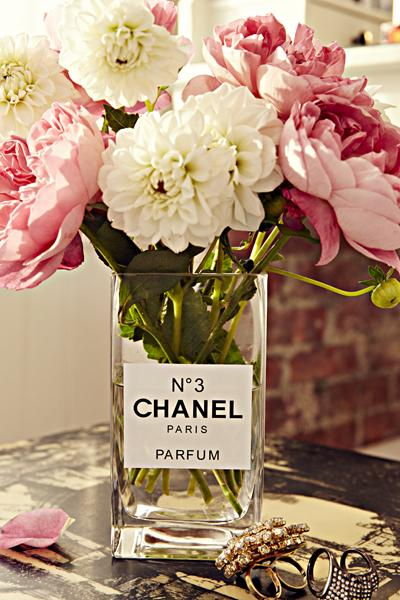 13. Chic Vase A snoozy vase gets an elegant makeover when you print out a sticker that makes it look like a perfume bottle. Can't make stickers in your printer? Draw a label on a piece of heavy paper and use glass glue.