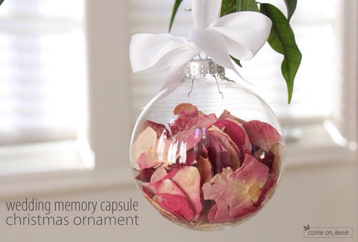Wedding bouquet flower petals in a clear glass ornament.