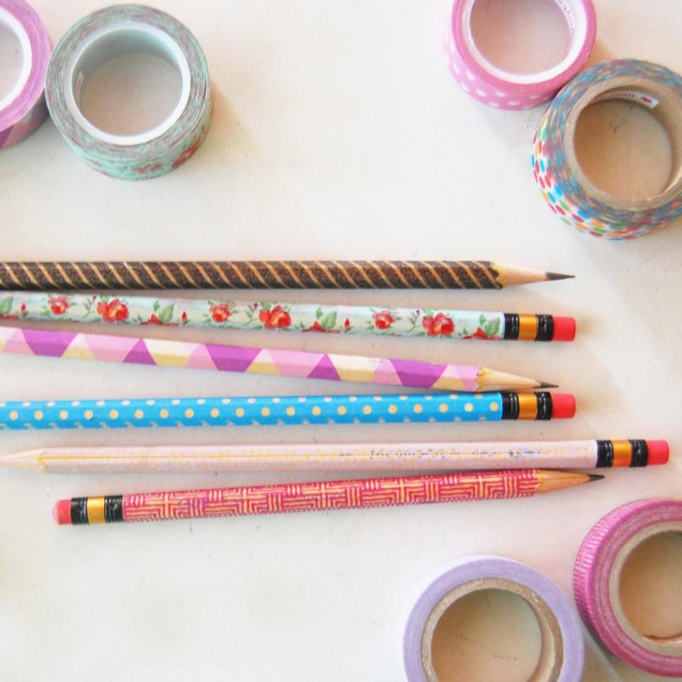 You can cover almost any school supply with washi tape and it will be instantly cuter. Pencils, for example, (and they sharpen just fine).
