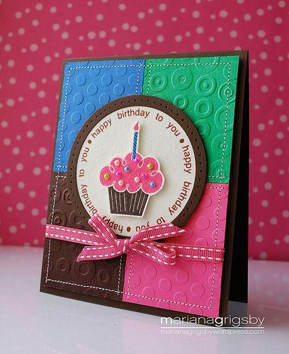 A cute birthday card with a brown card and different colors on the front and use a cute bow color and a cut out cupcake and candle