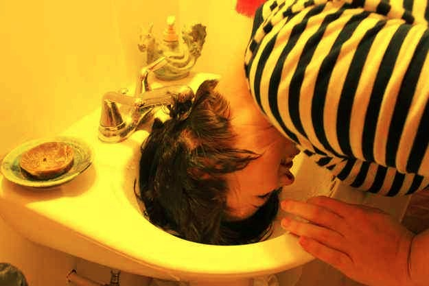 """10. If you have especially thick hair that takes forever to dry, try """"half-washing it"""" in the sink. Most of the oil begins with the scalp, so you're washing away the grease that's causing the flatness in half the time! This trick is also great if you get greasy bangs."""