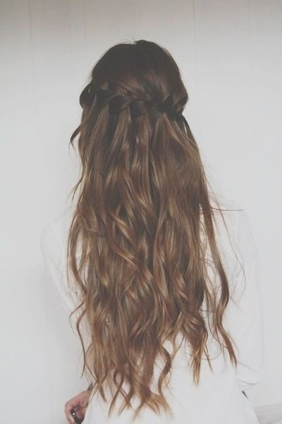 A knotted waterfall braid looks gorgeous atop long, glossy waves.