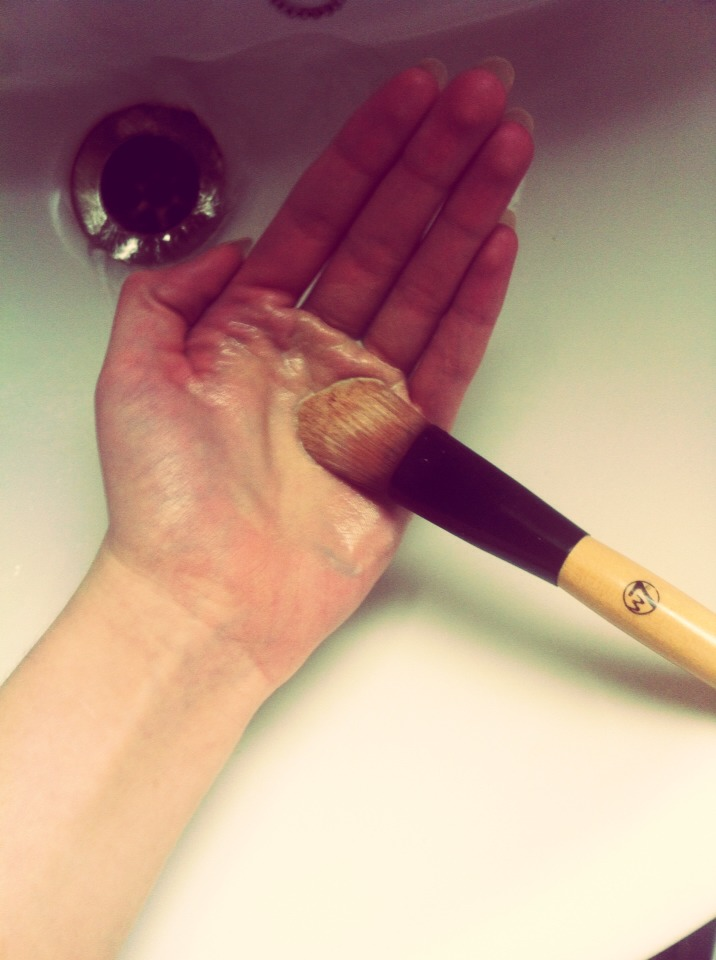 Swirl the dirty brush around the palm of your hand so it lathers with soap. You'll be able to see the makeup coming off the brush and changing the colour of the soap suds.