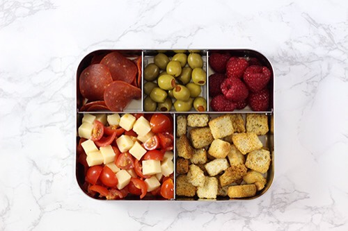 1 | Pizza-Inspired Lunch Combo This fun bento includes pepperoni, tomatoes & mozzarella, but instead of crust we opted for crunchy croutons! My five year old LOVES olives, so a big ole pile of them truly is a treat.  1. Turkey pepperoni 2. Tomato & mozzarella salad 3. Raspberries 4. Croutons 5. Oli