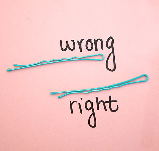 Place the bobby pins in your hair upside down. The grippier part was made to be on the bottom of the strands of hair that you place them in. It gives them more hold for the entire day!