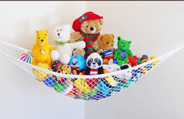 There's no clutter quite like shower-toy clutter. If you share a space with kiddos, chances are your tub looks like a public pool for plastic toys. Round up the playthings with a hammock. Make sure you hang it at kiddo's height, so they can be responsible for their own things.