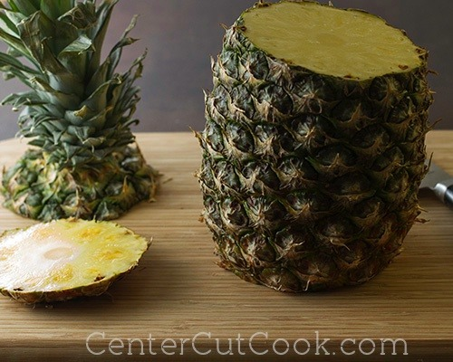 Step 1: Cut off the top and bottom off of the pineapple