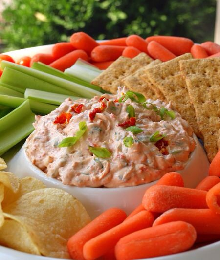 This dip is elegant summer party food. Think picnic, entertaining on the patio, outdoor concert on the grass, white wine, grown-ups, etc.  I had it for the first time at a party a few weeks ago. Let's just say, if an empty bowl is the sign of a good dish.