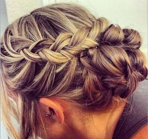 Side French braid wrapped up Into a bun.