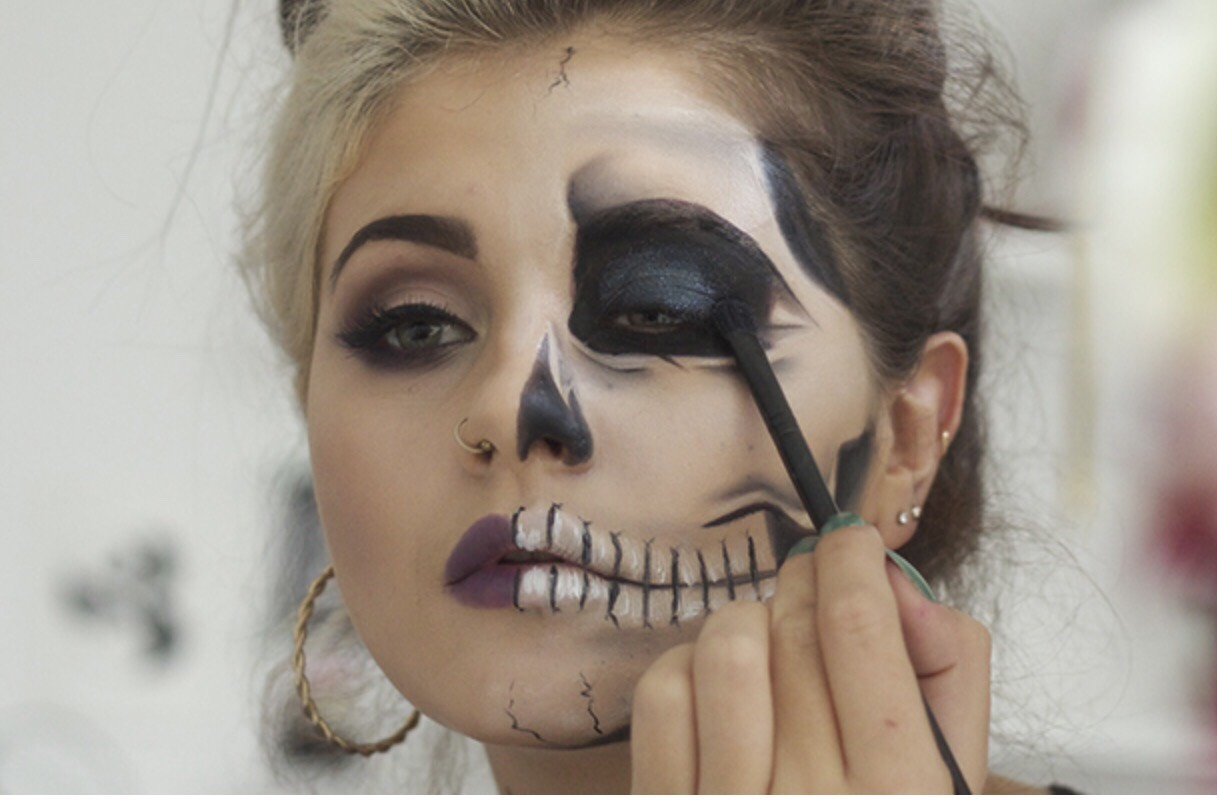 Add a touch more definition by using a white eyeliner pencil to fill in the teeth slightly, drawing on a few lines in each to create the look of teeth.