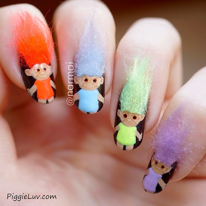 And if you want to attempt something even more out there, I'd say these furry Troll Doll nails are pretty much the best thing I've ever seen: