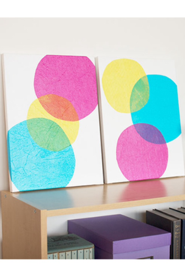 Cut circles out from tissue paper and glue them onto canvasses in any design you like!  Please like :)