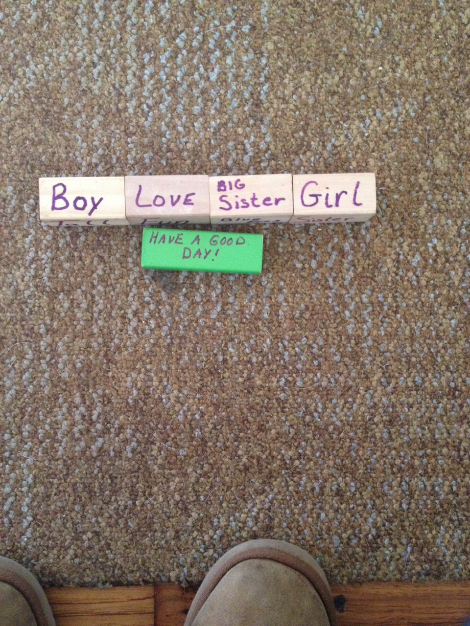 Write small word descriptions of each person on each side of there block i.e. There older brother Corey/coco says coco on one side brother on another boy on another and tall on the last side of the block this is great even for young children they will start to recognize their letters and numbers
