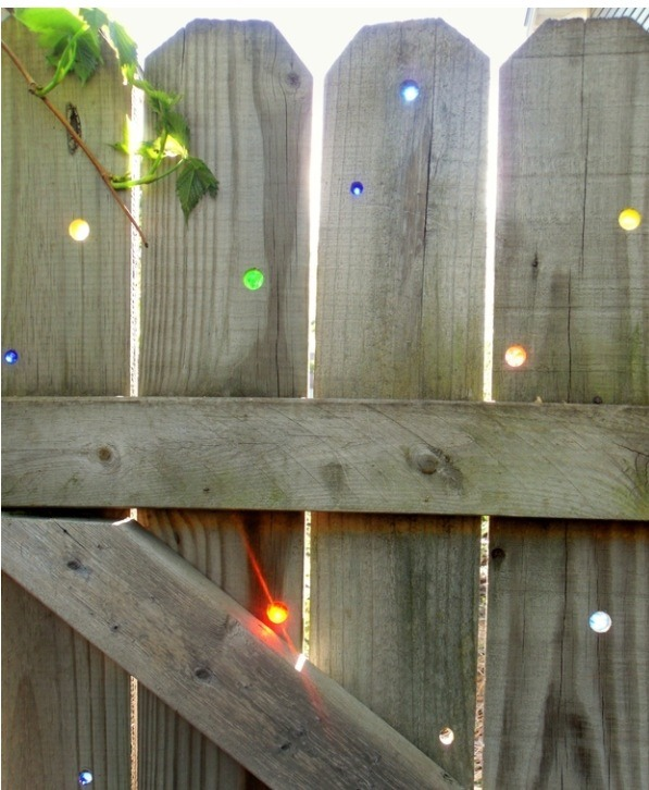 The marbles will cast pretty colored light onto your yard