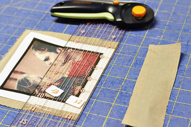 Use a ruler to trim the front piece leaving a 1/2″ border around the image.  You can trim the back piece at the same time.
