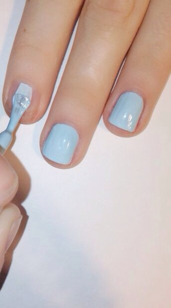 """Next apply your base color. This will be the background color in the cheetah print. Im using Essie """"Mint Candy Apple"""". This color is a pretty light blue. It takes me 3 coats to get it fully opaque. Different colors and brands will vary in coat 'usage'."""