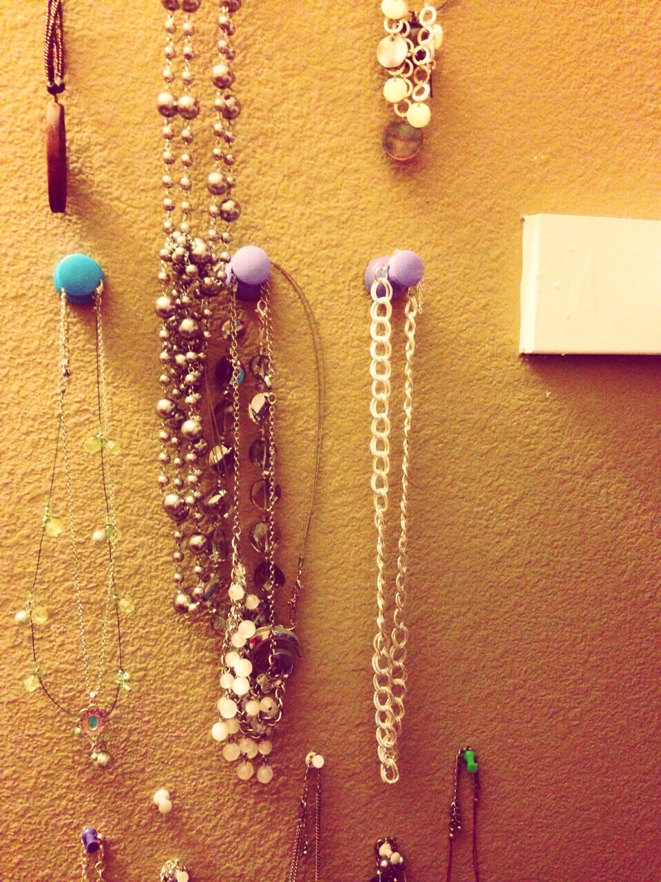 Push pins in various sizes / decorative or plain pushed into your closet wall.. Hang necklaces for east viewing ri ght by your wardrobe /  share