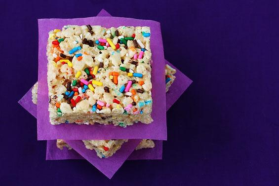 What you're gonna need:  4 Tbsp. butter 1 (10 oz.) bag of mini-marshmallows 1/2 cup yellow cake mix (the dry cake mix, not prepared into a batter!) 5 cups crispy rice cereal 1 (1.75 oz.) container of sprinkles  What you're gonna do...