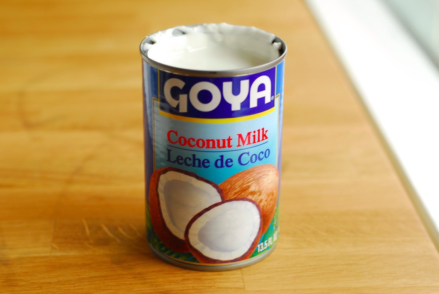 Pour 3/4 of the can of Cream of Coconut into a bowl.