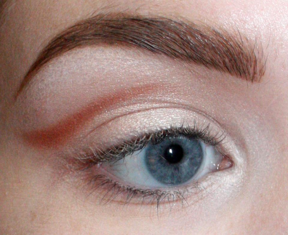 We are going to fake a crease here. Take whatever eyeshadow color you please (I'm using MAC's Coppertone blush) and draw a line just ABOVE your crease.