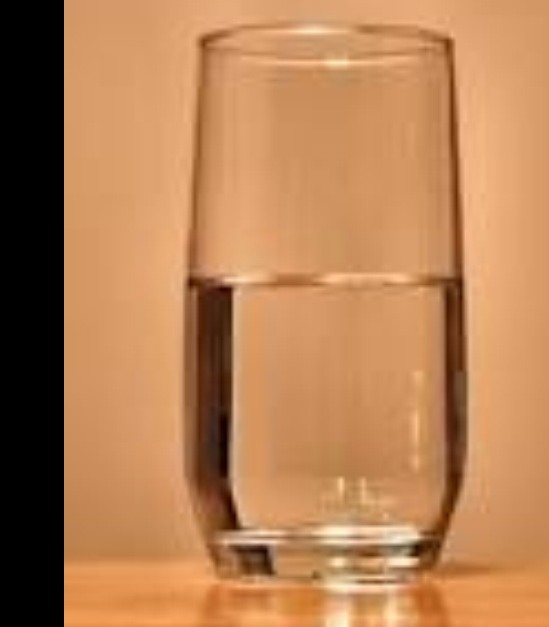 Half glass of hot water