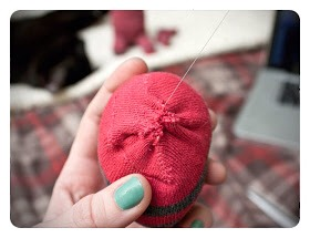 5.Hand stitch the head closed and then do the same to the neck of the body