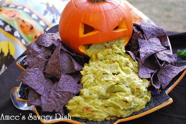 Guacamole From a Pumpkin.  Cool? Eww? I don't know, but it's definitely festive. All you need is a carved pumpkin, some chips, and your favorite guacamole.