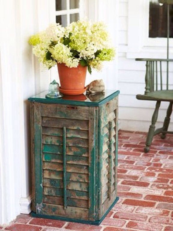 I love the rustic-chic feel of this side table made from old shutters. It doesn't even need a coat of paint!