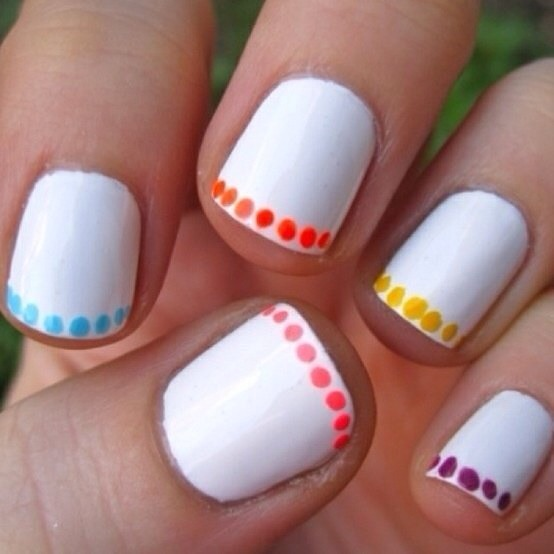 Adding a bit of accent to white nails can go a far way.  Step 1: add a coat of white polish and if needed add a second coat. Step 2: either a toothpick or a dotting tool add some colorful dots to the ends of your nails giving them a French tip inspired nail.