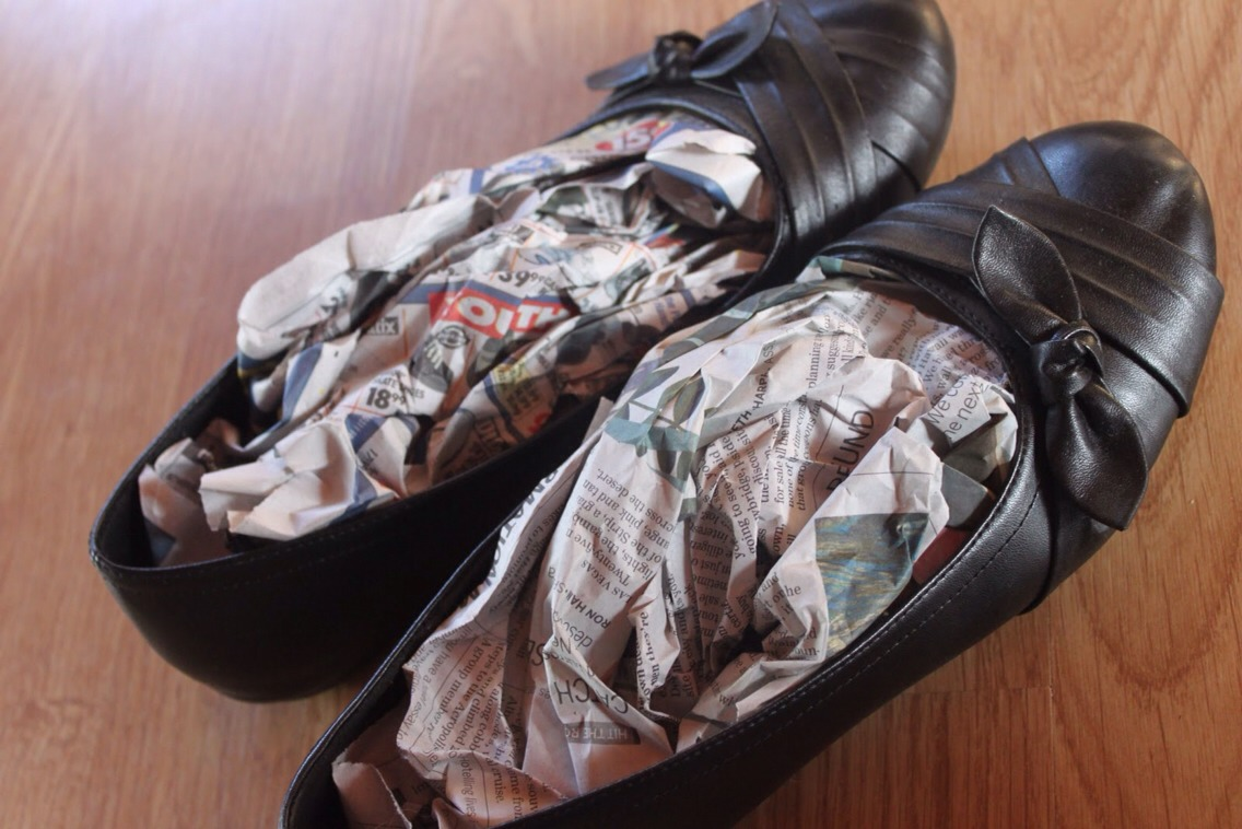 Stuff ur shoes with newspaper to absorb odor and moisture
