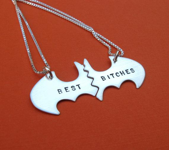 This Batman-inspired pendant.  But it here :https://www.etsy.com/listing/150671124/best-bitches-batman-necklaces?ref=listing-shop-header-0