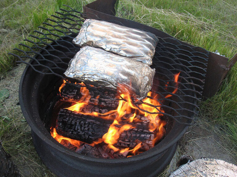 Reheat on your fire pit to save time in the morning while camping.