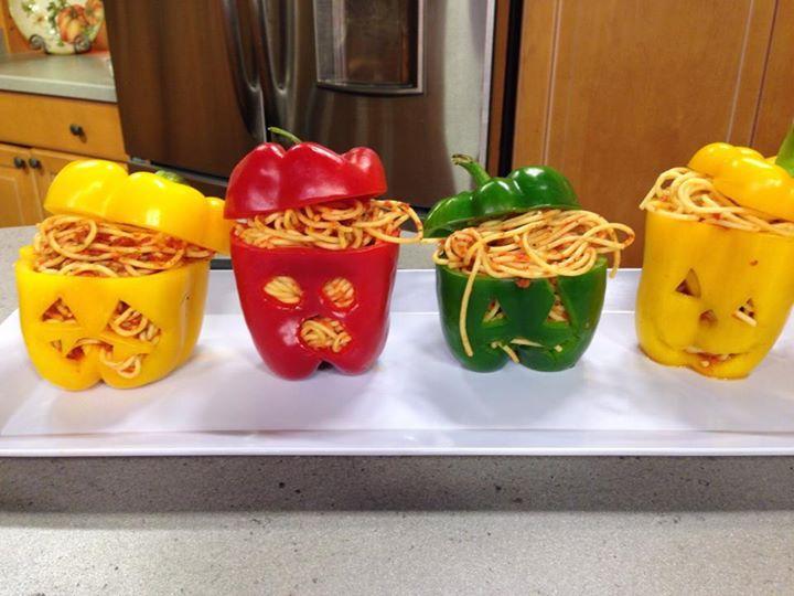pepper jack-o'-lanterns with spaghetti brains. Serve in raw pepper.. or bake them..