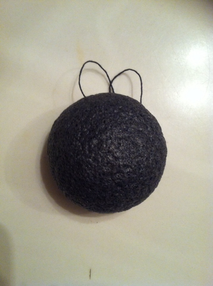 If you're wondering what it looks like, here it is! It's a little black sponge that about doubles in size when you get it wet. It's got a bit of texture to it which is great for some gentle exfoliation but it's not too harsh for your delicate facial skin! I even gently cleanse around my eyes!