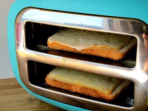 Just turn your toaster sideways and place your bread with cheese inside wait a few mins for cheesy goodness!