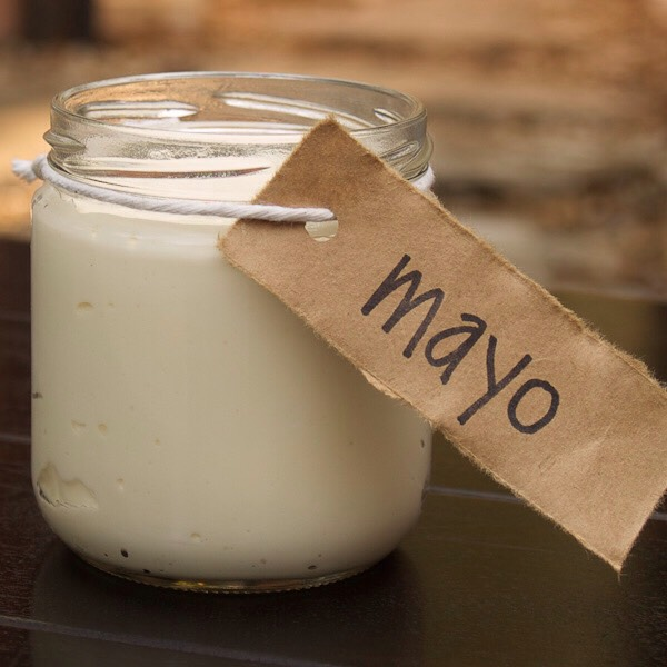 2 Spoonfuls of Mayo!!   Benefits of Mayo:   Mayo is made of Eggs and oil. So it makes sense to put in your hair.
