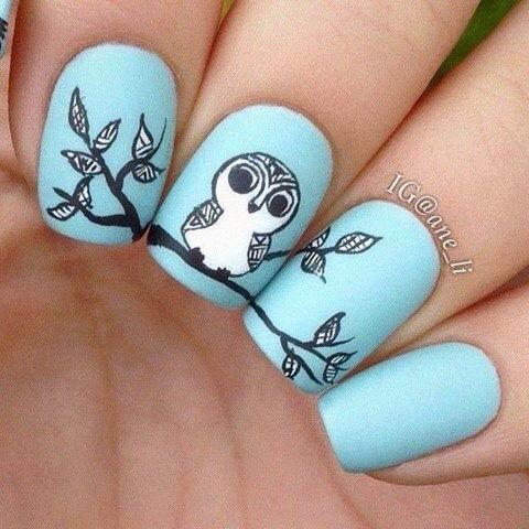 Beautiful owl nail art.