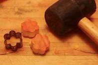 Pull the cookie cutters out the best way you can and pop the pumpkin pieces out. Now you have your designer pumpkin.