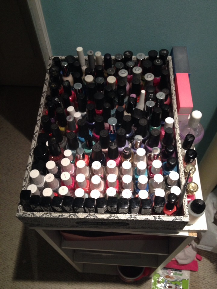 I use a food tray that I got for $10 at winners. It holds over 100 nail polishes. I put my cotton balls in an old bath and body works candle jar. You can find out how to get the unused wick out of the candle in one of my other posts.