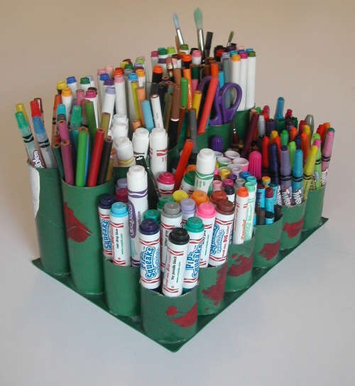 Use toilet paper rolls for decorative and unique styled organizers for writing utencils:)