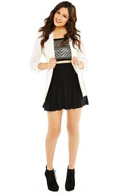 Black skirt + black booties + bling top + blazer = night out perfection