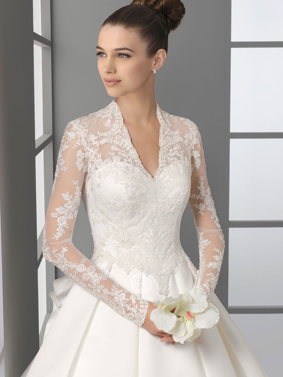 This dress is loose and has very nice lace on the upper part of the dress. This dress has a nice v-neck and has a big bow in the back. This dress is also a little warmer in case you are having an outside wedding.