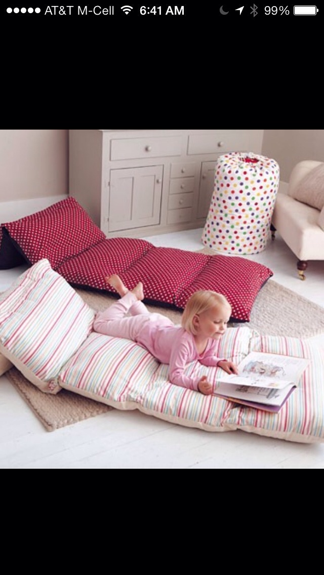 Sew some fabric over 4-6 pillow. Wallah