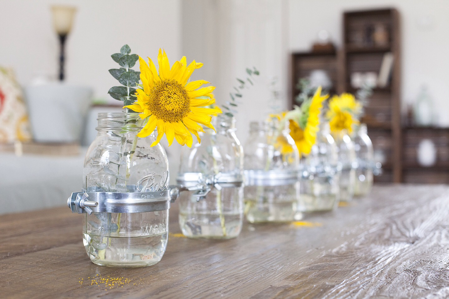 Beautiful center piece idea !!  Supply's needed: mason jars, fake or real flowers, water! cheap and easy!