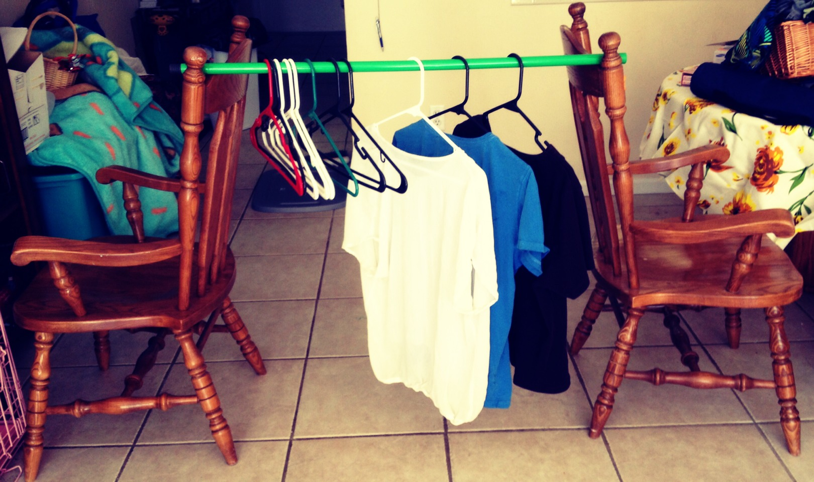 If you want to hang laundry in the living room or dining area, unscrew the brush from your broom and balance the ends on 2 back to back chairs. If you have someone who can carry an end, pick up the whole thing and carry it to where you wish to put it away! Enjoy! Please like :)
