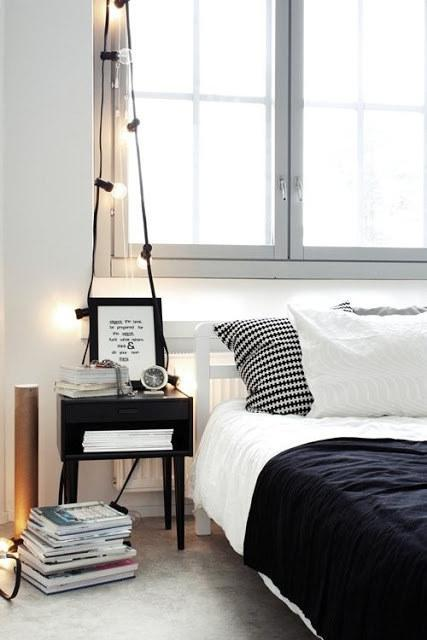 11. Drape bigger bulbs above your nightstand for the coziest lamp you could ask for.