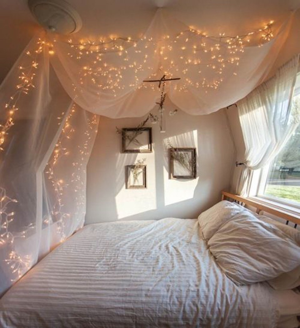 1. Canopy Drape: Drape them along the inside of your sheer canopy for a soft, glowy appearance. (Don't have a canopy? I've got a tip for that! Check out my tip on how to make a canopy bed using curtains and command strips!)