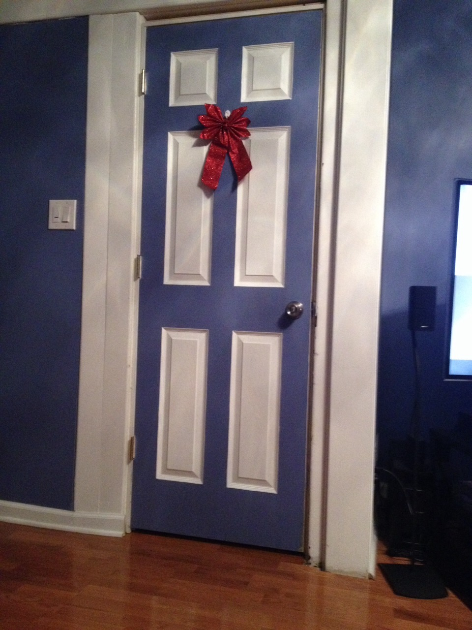 Paint your door with the wall color or a different color for a pop of color