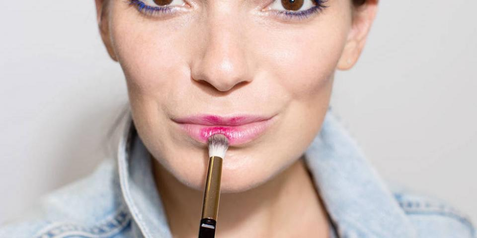 2. Apply wine-colored lipstick with an eye shadow brush to get a really soft, diffused look.