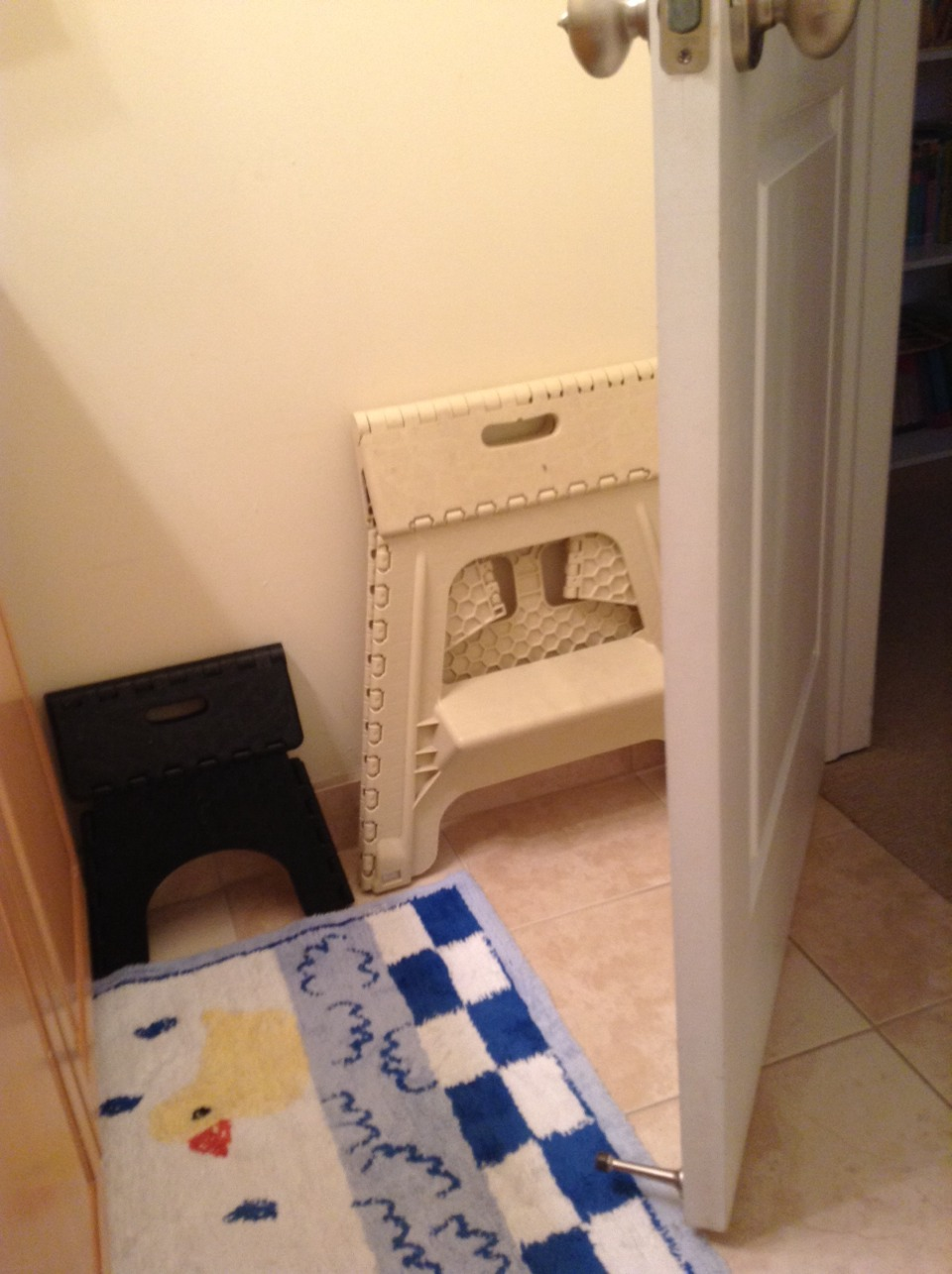 I keep my two stools behind my door to save space somewhere else in my room and/or house.